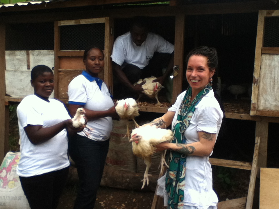 Volunteers in a poultry farm